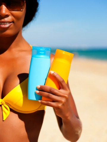 woman-at-the-beach-with-sunscreen